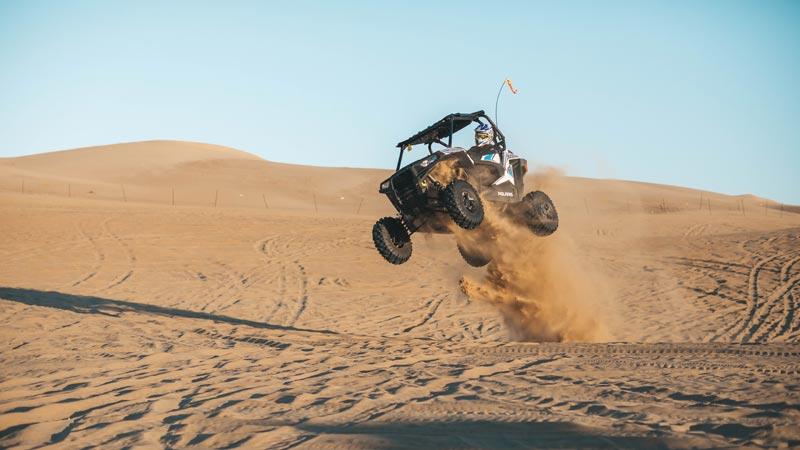 Polaris RZR jumping sand dunes